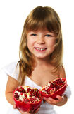 Little girl holding pomegranate Royalty Free Stock Images