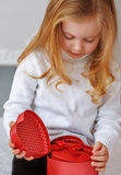 Little girl holding present in hands Royalty Free Stock Photography