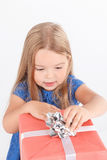 Little girl holding present Royalty Free Stock Photography