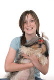 Little Girl Holding Puppy 1. Little girl with pig tails in her hair and a big smile holding a Shih Tzu puppy dog. Shot on white royalty free stock photos