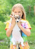 Little girl holding a puppy Royalty Free Stock Photos