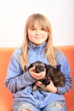Little girl holding a puppy stock images