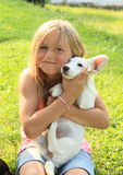 Little girl holding a puppy Royalty Free Stock Images