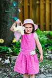 Little Girl Holding a Purse with an Easter Bunny Royalty Free Stock Images