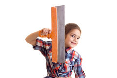 Little girl holding putty knife Stock Image