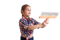 Little girl holding putty knife Royalty Free Stock Images