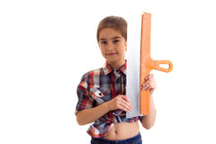 Little girl holding putty knife Stock Images