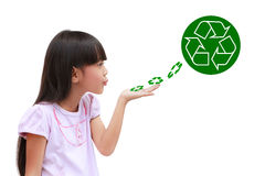 Little girl holding recycle symbol. Little girl holding and blowing recycle symbol isolated on white Stock Images