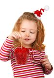 Little girl holding a red apple. Isolated on white background Stock Photo