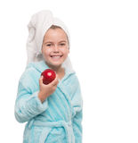 Little girl holding red apple beside her cheek Stock Image