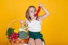 Little girl holding a red bell pepper healthy food vegetables stock photo