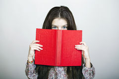 Little girl holding red book Stock Photography