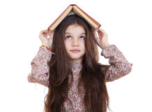 Little girl holding red book Royalty Free Stock Photo