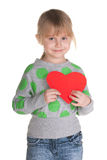 Little girl is holding a red heart Royalty Free Stock Images