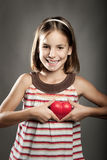 Little girl holding red heart Royalty Free Stock Photography