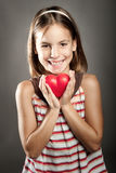 Little girl holding red heart Stock Photography