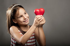 Little girl holding red heart Royalty Free Stock Images