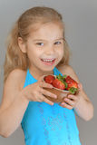Little girl holding red strawberries Royalty Free Stock Photography