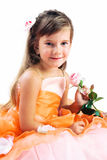 Little girl holding a rose isolated over white Royalty Free Stock Image