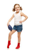Little girl holding a rugby ball Stock Photo