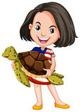 Little girl holding a sea turtle Royalty Free Stock Photos