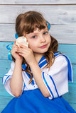 Little girl holding seashell Royalty Free Stock Photos