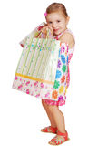 Little girl holding shopping bags Stock Photo