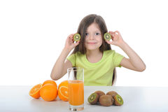 Little girl holding slices of kiwi Royalty Free Stock Photography