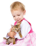 Little girl holding small kitten.  on white background Royalty Free Stock Photography