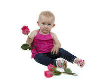 LIttle girl holding a small rose Stock Photos