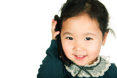 Little girl holding a smart phone. Isolated on white background. Close-up Royalty Free Stock Images