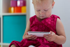 Little girl holding smartphone Stock Image