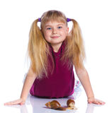 Little girl holding snails in hands Stock Photos