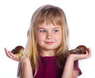 Little girl holding snails in hands Stock Image