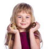 Little girl holding snails in hands Stock Photo