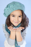 Little girl holding snow Stock Images