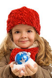 Little girl holding snow and christmas bauble Royalty Free Stock Photo