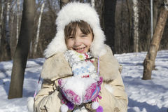 Little girl holding snow Royalty Free Stock Photo