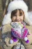 Little girl holding snow Royalty Free Stock Image