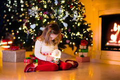 Little girl holding snow globe under Christmas tree Royalty Free Stock Photo
