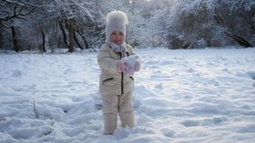 Little girl holding snow stock video footage