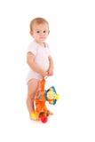Little girl holding soft toy monkey Royalty Free Stock Images