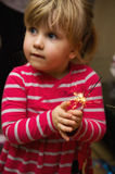 Little girl holding sparkler Stock Image