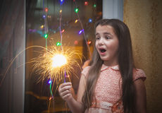 Little girl holding a sparkler Royalty Free Stock Photo