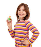 Little girl holding spring flower muffin Royalty Free Stock Images