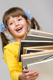 Little girl holding stack of books Stock Photography