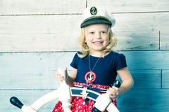 Little girl holding a steering wheel Stock Photos