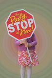 Little girl holding a stop sign inviting friends to her birthday party. Stock Photo