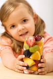Little girl holding a summer fruits salad Stock Photo