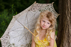 Little girl holding sunshade royalty free stock photo